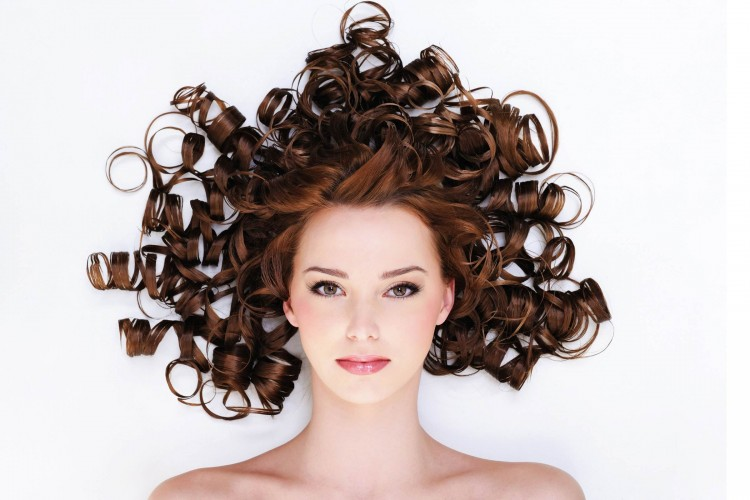 high angle portrait of the pretty young woman with beauty curly hairs -lyinh on the floor